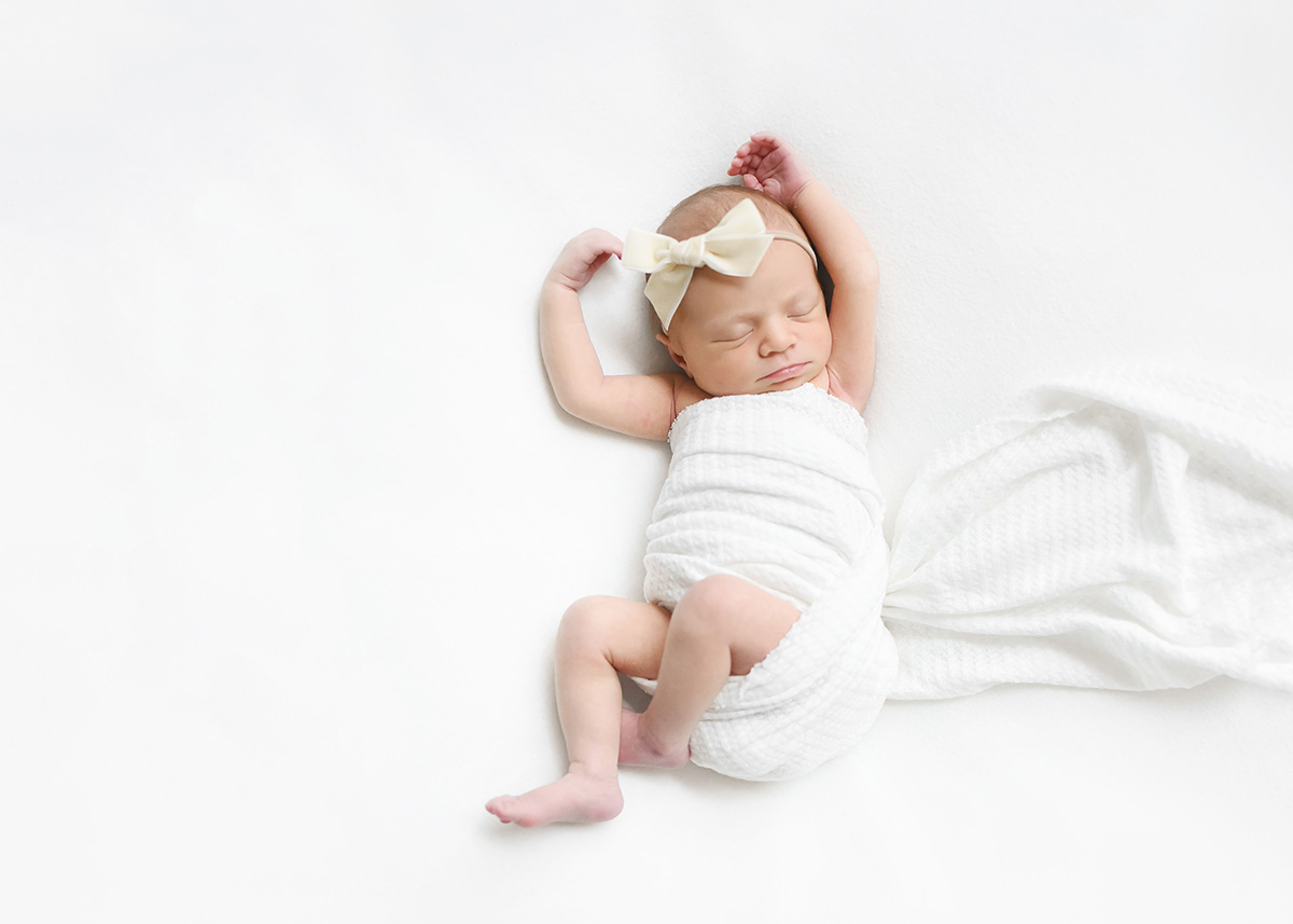 newborn baby in Houston on white blanket