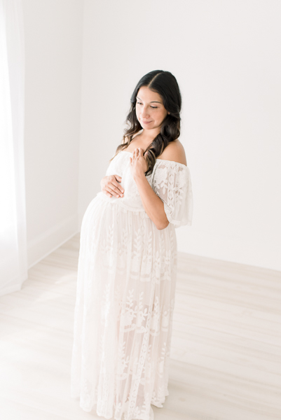 Mom in white dress during photo session with Houston maternity photographer