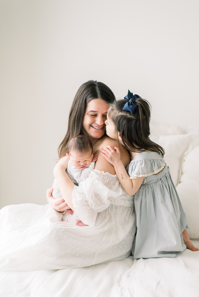mom with daughter during newborn session in Houston