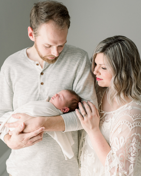 mom and dad with newborn during Houston Heights newborn session